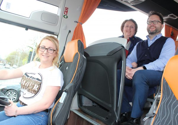 Leanne is pictured in a coach with jo and malc Lloyd of L&T Transport Training Services